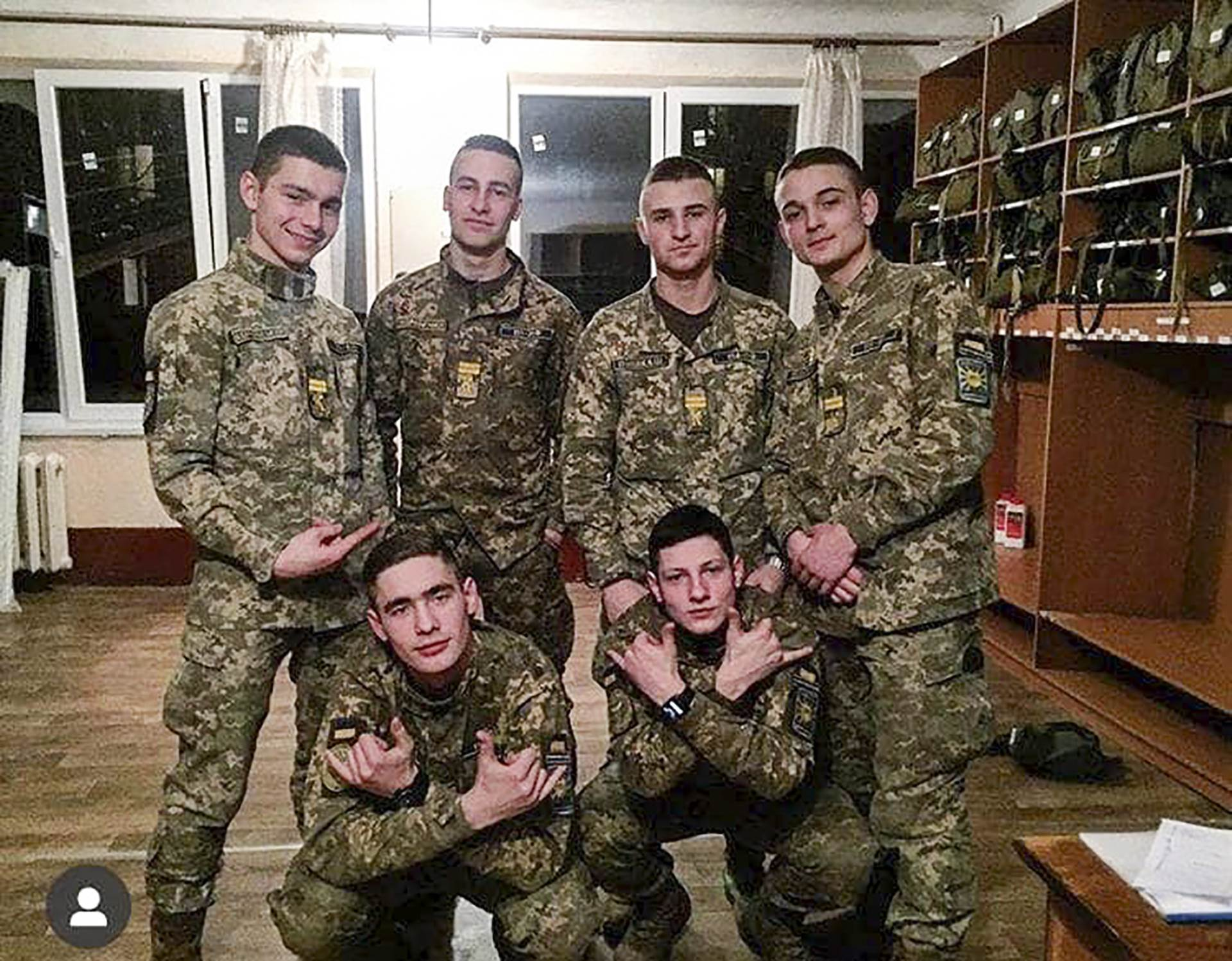 This undated photo provided by Ukraine's Police Saturday, Sept. 26, 2020 shows cadets of a military aviation school killed in an AN-26 military plane crash, pose for photo. AN-26 military plane crashed in the town of Chuhuiv close to Kharkiv late Friday Sept. 25, 2020, killing 26 of the 27 people aboard. The plane, a twin-turboprop Antonov-26 belonging to the Ukrainian air force, was carrying a crew of seven and 20 cadets of a military aviation school when it crashed and burst into flames while coming in for landing at the airport in Chuhuiv, about 400 kilometers (250 miles) east of the capital Kyiv. (Ukrainian Police Press Office via AP)