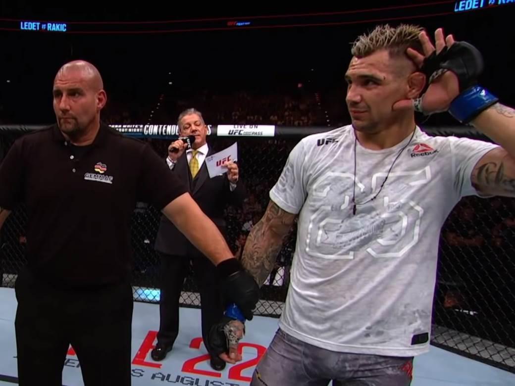 Aleksandar Rakić MMA sudija oktagon osluškuje ruka na uvetu