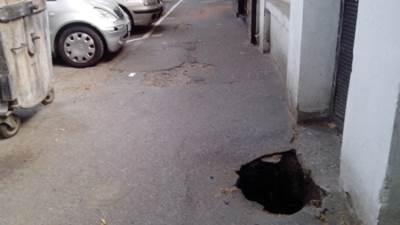 rupe rupa asfalt ulica trotoar